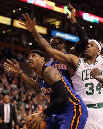 Carmelo Anthony #7 of the New York Knicks heads for the net as teammate Amare Stoudemire #1 blocks Paul Pierce #34 of the Boston Celtics