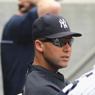 Captain Derek Jeter #2 of the New York Yankees looks on from the dugout during ther game against the Boston Red Sox at Yankee Stadium on September 8, 2013 in the Bronx borough of New York City.