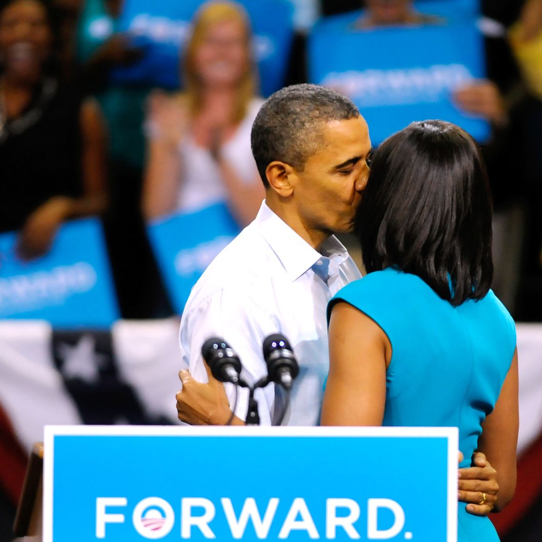 U.S. President Barack Obama gives first lady Michelle Obama a kiss after she introduced him before his speech at a campaign rally at the Virginia Commonwealth University May 5, 2012 in Richmond, Virginia. President Obama officially kicked off his 2012 campaign for reelection today.