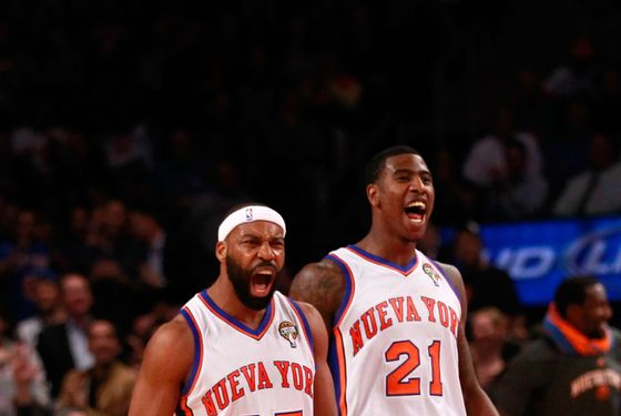 NEW YORK, NY - MARCH 14: (L) Baron Davis #85 of the New York Knicks and (R) Iman Shumpert #21 of the New York Knicks react during the game againt the Portland Trail Blazers at Madison Square Garden on March 14, 2012 in New York City. NOTE TO USER: User expressly acknowledges and agrees that, by downloading and/or using this Photograph, user is consenting to the terms and conditions of the Getty Images License Agreement.  (Photo by Chris Trotman/Getty Images)