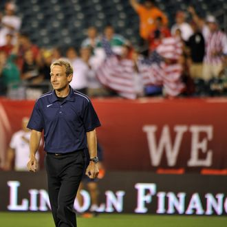 Team USA coach Jurgen Klinsmann is cheered as he walks onto the field before the start of their international friendly match against team Mexico at Lincoln Financial Field in Philadelphia on August 10, 2011. AFP PHOTO/Nicholas KAMM (Photo credit should read NICHOLAS KAMM/AFP/Getty Images)