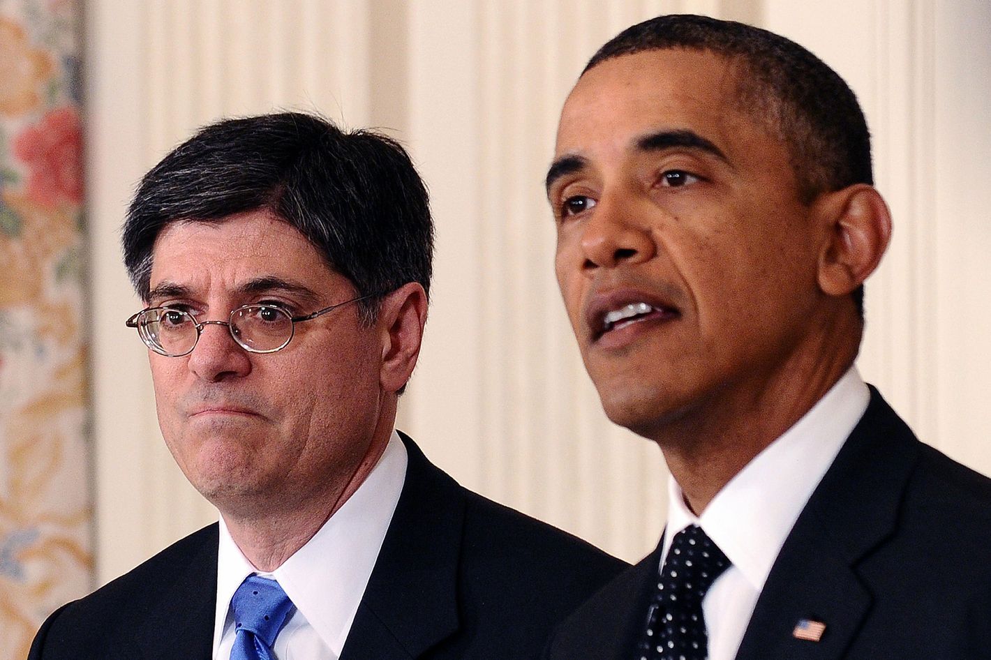 US President Barack Obama (R) speaks to announce change of his chief of staff at the State Dinning Room of the White House in Washington, DC, on January 9, 2012 as his replacement chief of staff Jacob Lew looks on.