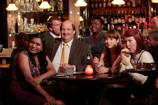 "THE OFFICE -- ""Trivia"" Episode 811 -- PIctured: (l-r) Mindy Kaling as Kelly Kapoor, Brian Baumgartner as Kevin Malone, Ellie Kemper as Kelly Erin Hannon, Kate Flannery as Meredith Palmer."