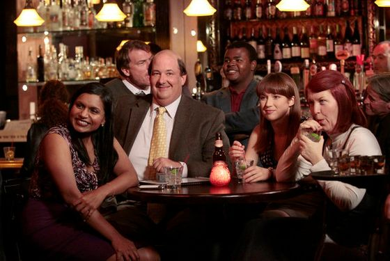"THE OFFICE -- ""Trivia"" Episode 811 -- PIctured: (l-r) Mindy Kaling as Kelly Kapoor, Brian Baumgartner as Kevin Malone, Ellie Kemper as Kelly Erin Hannon, Kate Flannery as Meredith Palmer -- Photo by: Chris Haston/NBC"