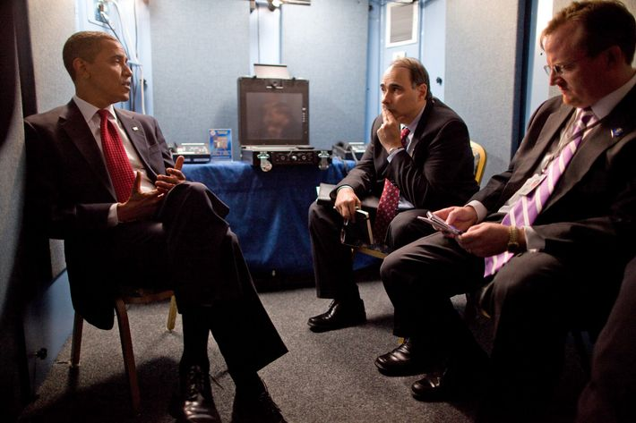 President Barack Obama confers with Senior Advisor David Axelrod and Press Secretary Robert Gibbs at their hotel in Moscow, Russia, July 6, 2009.   (Official White House Photo by Pete Souza)This official White House photograph is being made available for publication by news organizations and/or for personal use printing by the subject(s) of the photograph. The photograph may not be manipulated in any way or used in materials, advertisements, products, or promotions that in any way suggest approval or endorsement of the President, the First Family, or the White House.