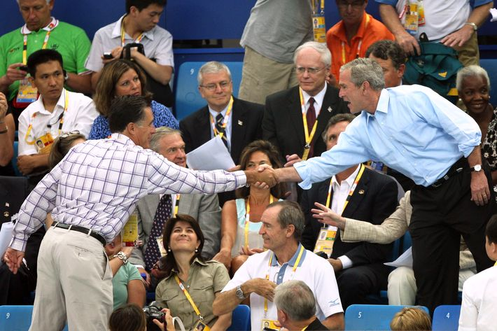 President of the United States, George W. Bush shakes hands with former Republican presidential hopeful and former Massachusetts Governor Mitt Romney at the swimming arena at the National Aquatics Center during day 2 of the Beijing 2008 Olympic Games on August 10, 2008 in Beijing, China.