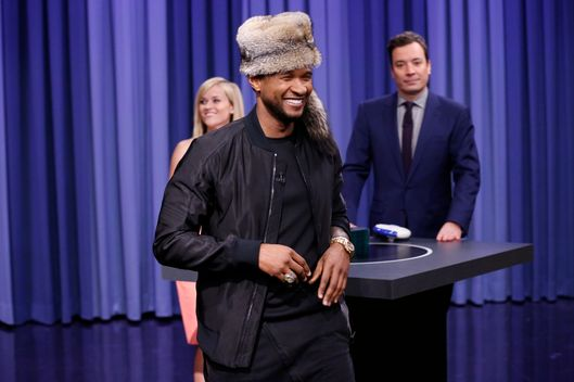 THE TONIGHT SHOW STARRING JIMMY FALLON -- Episode 0005 -- Pictured: (l-r) Usher and Jimmy Fallon play a game of Catch Phrase on February 24, 2014 -- (Photo by: Lloyd Bishop/NBC/NBCU Photo Bank)