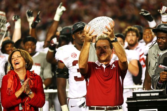 Head coach Nick Saban of the Alabama Crimson Tide celebrates with the BCS Coaches' Trophy as his wife Terry looks on after defeating the Notre Dame Fighting Irish in the 2013 Discover BCS National Championship game at Sun Life Stadium on January 7, 2013 in Miami Gardens, Florida. Alabama won the game by a score of 42-14.