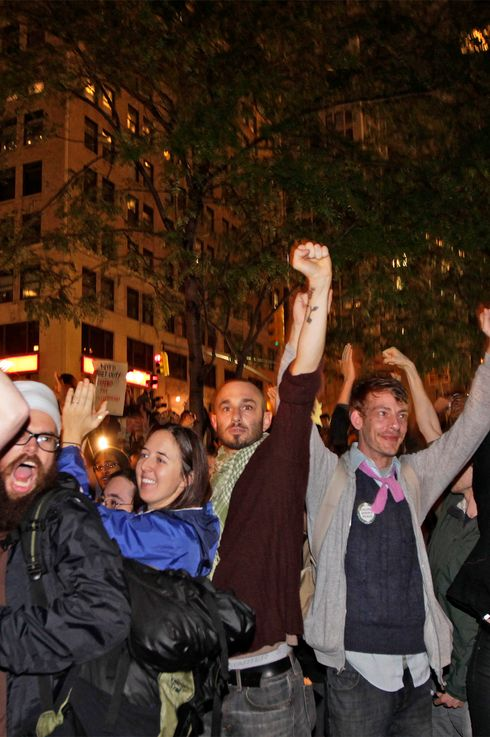 Members of the Occupy Wall St movement react after an announcement that a planned cleaning has been suspended in Zuccotti Park, near the financial district of New York October 14, 2011. REUTERS/Lucas Jackson (UNITED STATES - Tags: BUSINESS CIVIL UNREST)