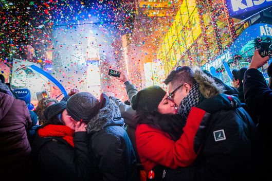 Couples kiss after midnight in Times Square during the New Years Eve celebration on January 1, 2013 in New York City. An estimated one million revelers from around the world endured long hours of cold weather to have a front seat to this year's star studded celebration.