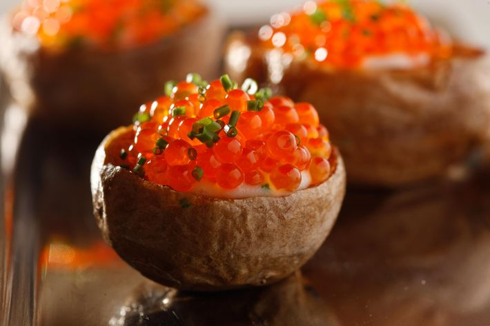 Mini double-baked potatoes with caviar.
