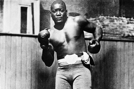 Shown in a fighting pose is Jack Johnson former heavyweight champion of the world.  Undated photo, filed 6/11/1946.