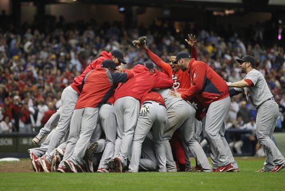 MILWAUKEE, WI - OCTOBER 16:  The St. Louis Cardinals celebrate after they won 12-6 against the Milwaukee Brewers during Game Six of the National League Championship Series at Miller Park on October 16, 2011 in Milwaukee, Wisconsin.  (Photo by Jonathan Daniel/Getty Images)