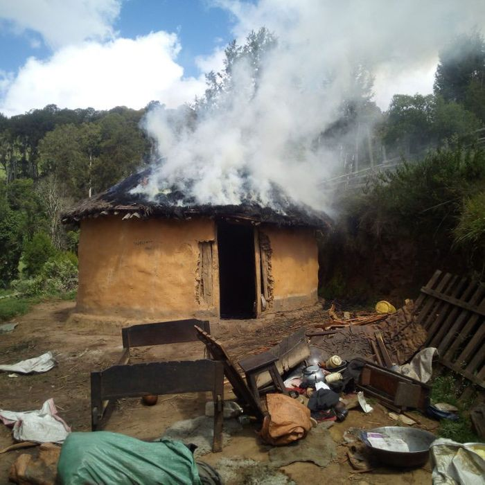 A Sengwer cottage burns, lit on fire by the Kenyan military.