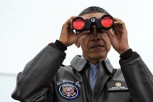 US President Barack Obama looks through binoculars towards North Korea from Observation Post Ouellette during a visit to the Joint Security Area of the Demilitarized Zone (DMZ) near Panmunjom on the border between North and South Korea on March 25, 2012. Obama arrived in Seoul earlier in the day to attend the 2012 Seoul Nuclear Security Summit to be held on March 26-27.   AFP PHOTO / Jewel Samad (Photo credit should read JEWEL SAMAD/AFP/Getty Images)