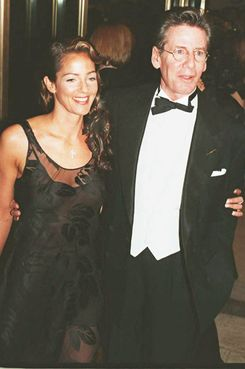 Fashion designer Calvin Klein arrives with his wife Kelly at the Fourteenth Annual Council of Fashion Designers of America Awards Gala at the Lincoln Center in New York 30 January 1995. Princess Diana will be presenting an award during the evening which honors achievements in fashion during 1994.