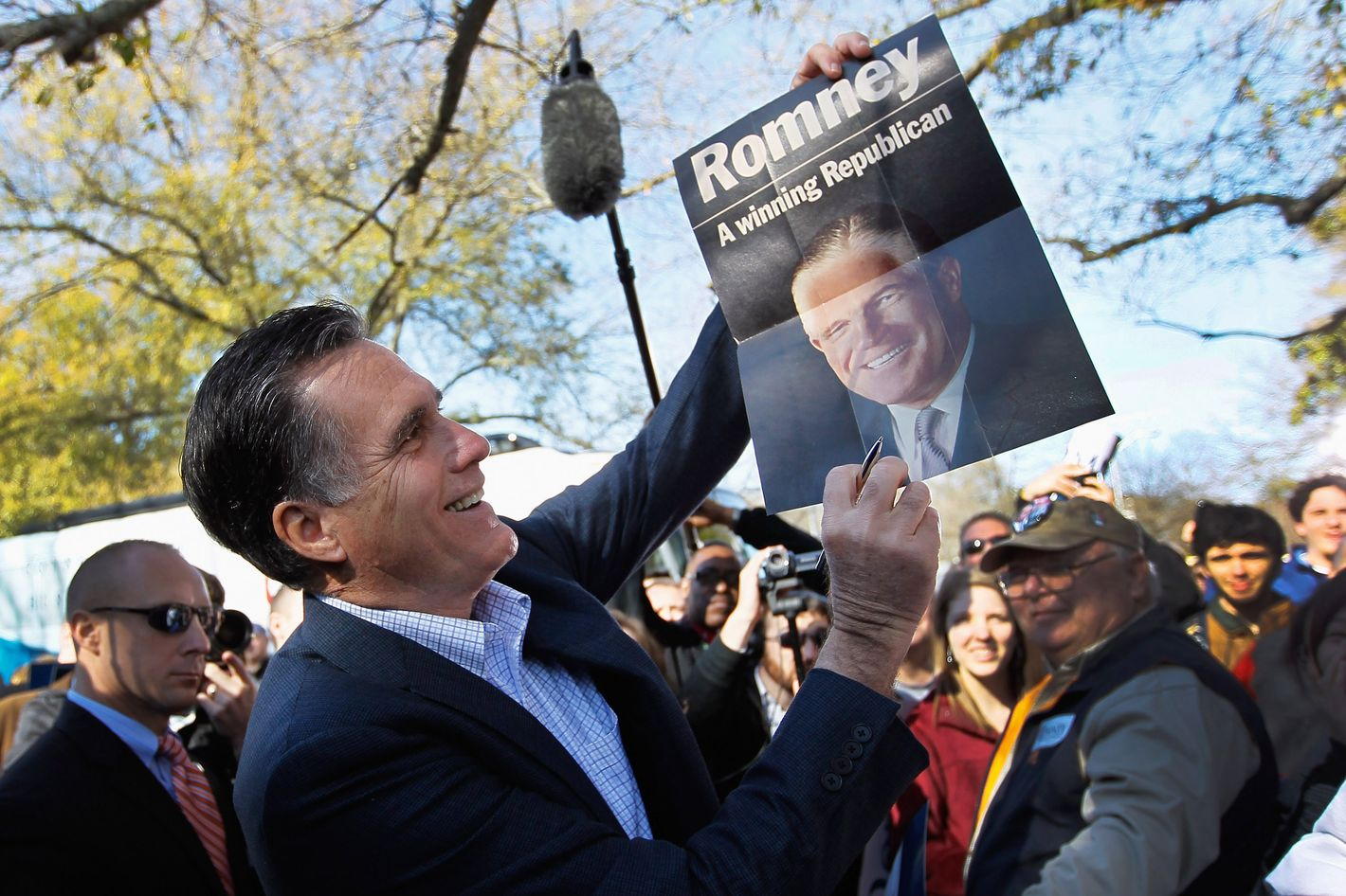 SPARTANBURG, SC - JANUARY 18: Republican presidential candidate and former Massachusetts Gov. Mitt Romney holds up a poster of his father, George Romney, who was the former governor of Michigan, after it was given to him while greeting people at a campaign rally at Wofford College on January 18, 2012 in Spartanburg, South Carolina. Romney continues to campaign for votes in South Carolina ahead of their primary on January 21.  (Photo by Joe Raedle/Getty Images)