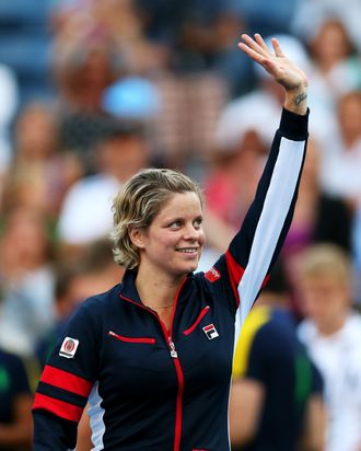 Kim Clijsters of Belgium waves to the crowd before walking off court following her defeat to Laura Robson of Great Britain after their women's singles second round match on Day Three of the 2012 US Open at USTA Billie Jean King National Tennis Center on August 29, 2012 in the Flushing neigborhood of the Queens borough of New York City.