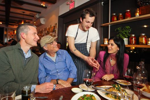 Grant van Gameren, Enoteca Sociale's new executive chef serves the diners with NYC food writer Mark Bittman . Sitting with Mark are The Stop's Nick Saul (left) and Real Foods for Real Kids Lulu Cohen-Farnell (right)   February 6, 2012  DAVID COOPER/TORONTO STAR
