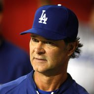 PHOENIX, AZ - MAY 22:  Manager Don Mattingly #8 of the Los Angeles Dodgers looks on from the dugout during action of a MLB game against the Arizona Diamondbacks at Chase Field on May 22, 2012 in Phoenix, Arizona.  (Photo by Ralph Freso/Getty Images)