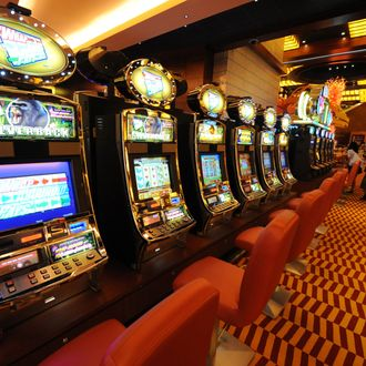 A row of slot machines await gamblers at the opening of Singapore's first casino, the Resorts World Sentosa complex, in Singapore on February 14, 2010. Singapore's first casino opened for business when the first punter was allowed into the gaming section of Resorts World Sentosa complex. The opening -- to be followed within months by a second casino resort -- is part of a multi-billion-dollar effort to transform Singapore's tourism industry.