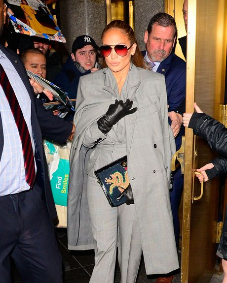 Jennifer Lopez in a gray coat