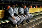 (L-R) Alex Rodriguez #13, Eduardo Nunez #26, Robinson Cano #24 and Mark Teixeira #25 of the New York Yankees look on from the dugout late in the game against the Detroit Tigers during game four of the American League Championship Series at Comerica Park on October 18, 2012 in Detroit, Michigan.