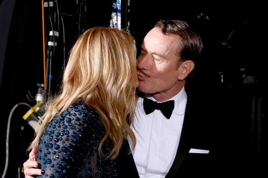 LOS ANGELES, CA - AUGUST 25:  66th ANNUAL PRIMETIME EMMY AWARDS -- Pictured: (l-r) Actors  Julia Roberts  and Bryan Cranston, winner of the award for Outstanding Lead Actor in a Drama Series, backstage during the 66th Annual Primetime Emmy Awards held at the Nokia Theater on August 25, 2014.  (Photo by Christopher Polk/NBC/NBC via Getty Images)