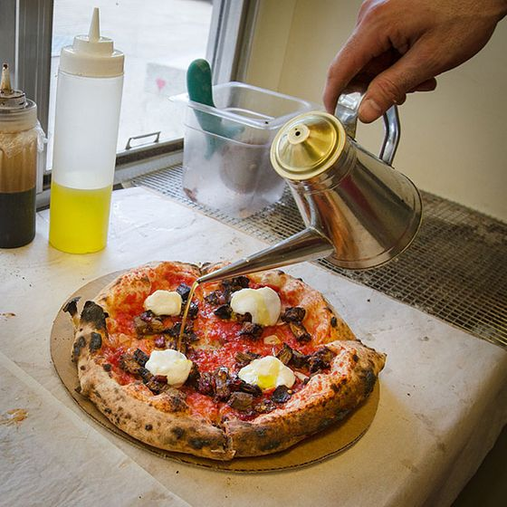 "<b>Eggplant</b>    <a href=""http://pitrucopizza.com/"">Pitruco</a>    <i>Philadelphia</i>  Don't let the fact that the wood-fired oven that Jonah Fliegelman and his friends turn out at Pitruco's pizzas from sits atop four wheels fool you. They are no novelty. As far as classic Neapolitan pies in Philly go, these are as legit as they come. Pictured here is Fliegelman finishing a whipped-ricotta and roasted eggplant pie with a drizzle of olive oil — just as tradition dictates."