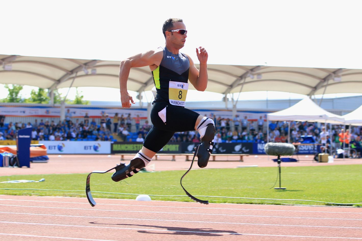 Oscar Pistorius of South Africa on his way to victory in the men's T42/43/44 200m during day one of the BT Paralympic World Cup at Sportcity on May 22, 2012 in Manchester, England.