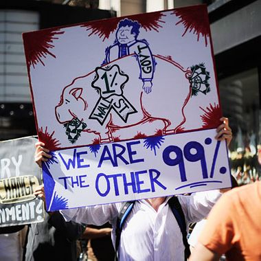 "LOS ANGELES, CA - OCTOBER 01:  Protesters hold signs as they march to Los Angeles City Hall during the ""Occupy Los Angeles"" demonstration in solidarity with the ongoing ""Occupy Wall Street"" protest in New York City on October 1, 2011 in Los Angeles, California. The protesters slogan, ""We are the 99 percent,"" calls attention to the fact that marchers are not part of the 1 percent of Americans who hold a vast portion of the nation's wealth.  (Photo by Kevork Djansezian/Getty Images)"