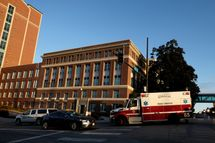 OMAHA, NEBRASKA - OCTOBER 6: An ambulance carrying an American freelance cameraman who contracted Ebola in Liberia, Ashoka Mukpo, arrives at the Nebraska Medical Center October 6, 2014 in Omaha, Nebraska. Mukpo is the fifth American diagnosed with Ebola and is reported to be in good spirits. (Photo by Eric Francis/Getty Images)