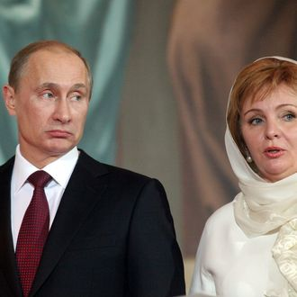 Russia's Prime Minister Vladimir Putin (L) and his wife Lyudmila Putina (R) pray during an Orthodox Easter service in the Christ the Saviour Cathedral on April 24, 2011 in Moscow, Russia. This year, Orthodox and Catholic churches are celebrating Easter on the same date.