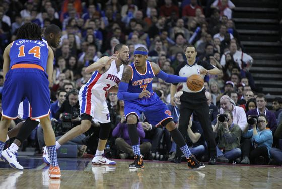 Carmelo Anthony #7 of the New York Knicks posts up Tayshaun Prince #22 of the Detroit Pistons during  a game between the New York Knicks and the Detroit Pistons at the 02 Arena on January 17, 2013 in London, England.
