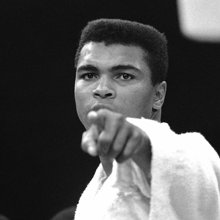 Heavyweight champion Muhammad Ali is momentarily displeased after weigh-in ceremony, May 25, 1965 in Lewiston, Maine, arena. Challenger Sonny Liston will be the object of Ali?s more potent attentions in 15-round title bout tonight. Liston weighed 215 ¼ and Clay 206. (AP Photo)