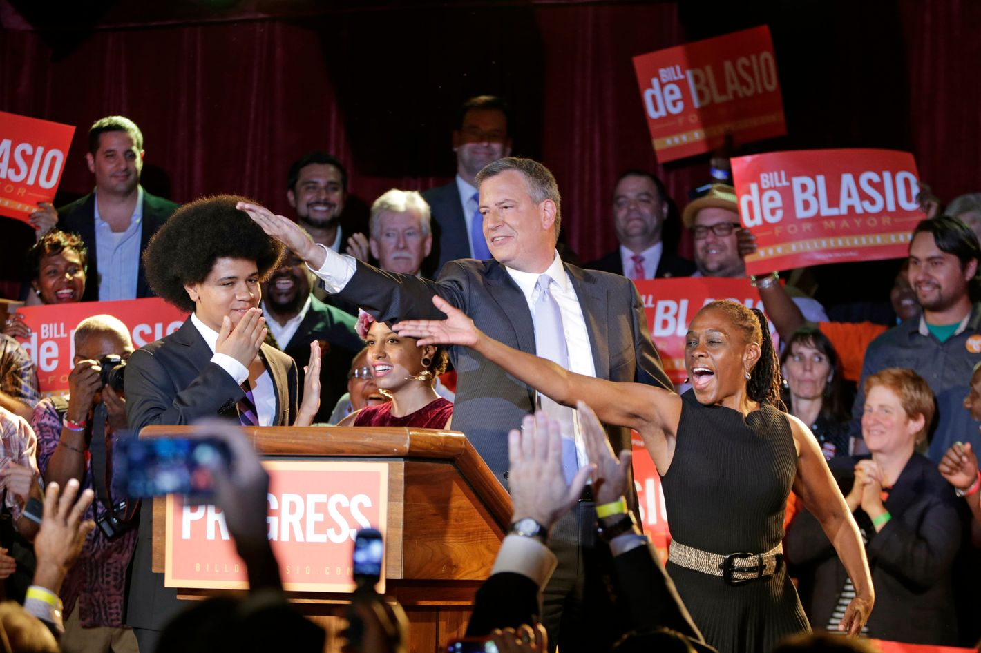 "New York City Democratic Mayoral candidate Bill De Blasio his wife Chirlane, right, and son Dante, left, dances the ""smack down"" after addressing supporters at his election headquarters after polls closed in the city's primary election Wednesday, Sept. 11, 2013, in New York. (AP Photo/Kathy Willens)"