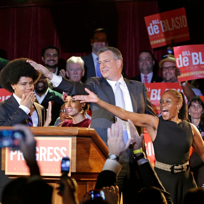 New York City Democratic Mayoral candidate Bill De Blasio his wife Chirlane, right, and son Dante, left, dances the