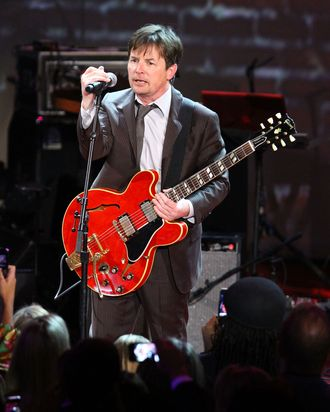 NEW YORK, NY - NOVEMBER 12: (EXCLUSIVE COVERAGE) Michael J. Fox performs onstage at the 2011 A Funny Thing Happened On The Way To Cure Parkinson's event at The Waldorf=Astoria on November 12, 2011 in New York City. (Photo by Mike Coppola/Getty Images for the Michael J. Fox Foundation for Parkinson's Research)