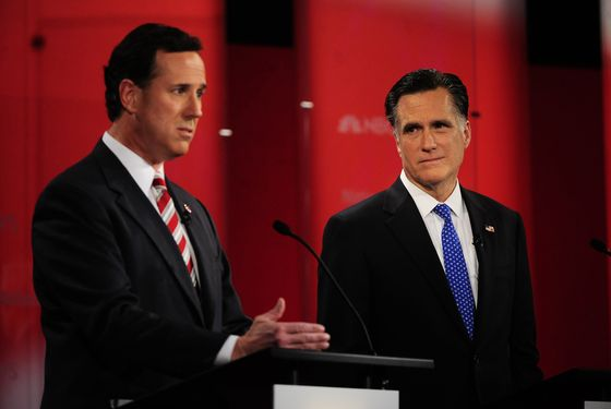 Republican presidential hopefuls Rick Santorum and Mitt Romney take part in The Republican Presidential Debate at University of  South Florida in Tampa, Florida, January 23, 2012. Florida will hold its Republican primary on January 31, 2012.  AFP PHOTO/Emmanuel Dunand (Photo credit should read EMMANUEL DUNAND/AFP/Getty Images)