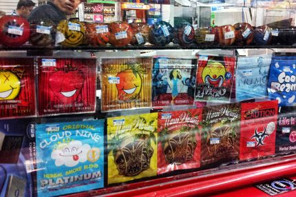 Synthetic marijuana, sold in colorful packages with names like Cloud Nine, Maui Wowie and Mr. Nice Guy, sits behind the glass counter at a Kwik Stop in Hollywood, Florida. Police are beginning to crack down on synthetic drugs.