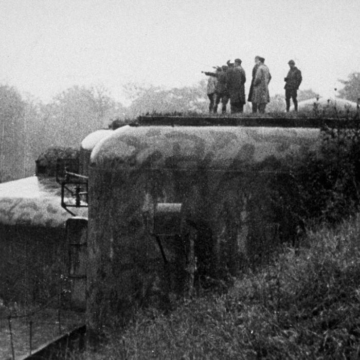 circa 1939: A French officer points in the direction of Berlin, from a fort on the Maginot Line.