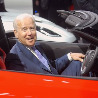 U.S. Vice-President Joe Biden sits in a Corvette at the North American International Auto Show industry preview at Cobo Hall on January 16, 2014 in Detroit, Michigan.