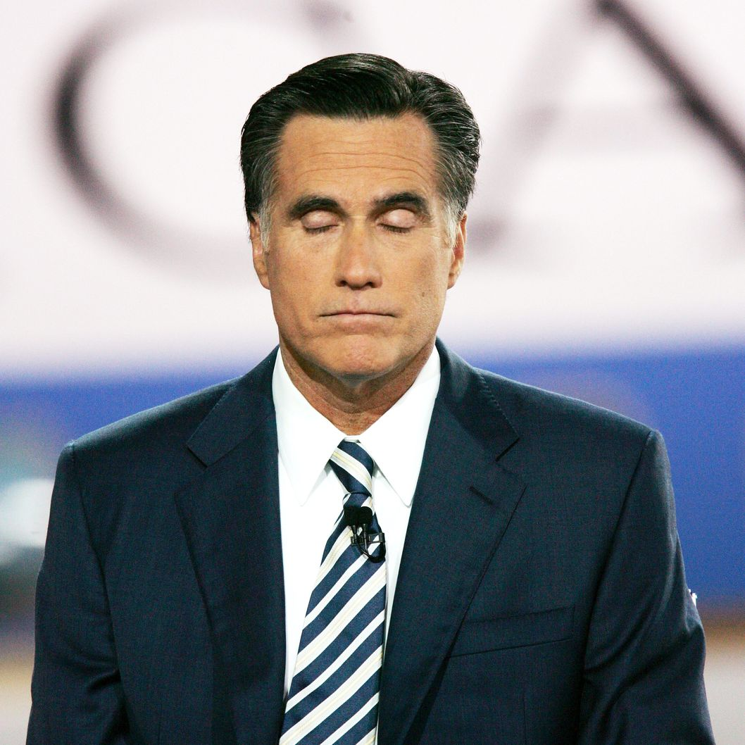 Former Massachusetts governor Mitt Romney shuts his eyes during the CNN/LA Times/Politico GOP Presidential Candidates' Republican Debate at the Ronald Reagan Presidential Library January 30, 2008 in Simi Valley, California.