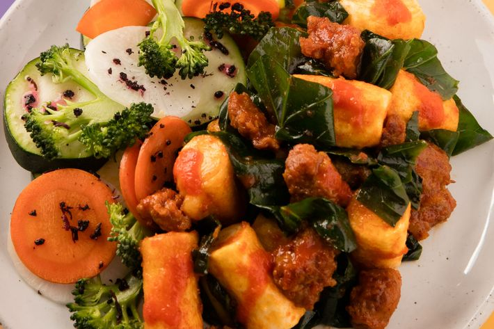Spicy Korean rice cakes with sausage and Chinese broccoli.