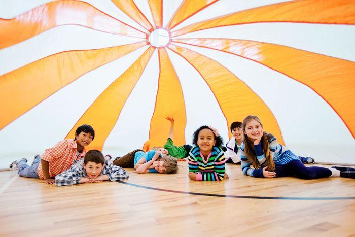 Kids inside a parachute.