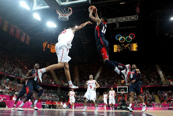 Anthony Davis #14 of United States dunks the ball over Salah Mejri #15 of Tunisia during the Men's Basketball Preliminary Round match on Day 4 of the London 2012 Olympic Games at Basketball Arena on July 31, 2012 in London, England.