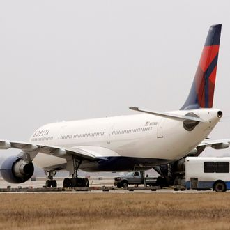 ROMULUS - DECEMBER 27: A Delta Airlines jet sits at a remote part of the Detroit Metropolitan Airport following an alleged incident with a Nigerian passenger December 27, 2009 in Romulus, Michigan. On Christmas day, another Nigerian man allegedly attempted to blow up the same Delta airlines flight that was landing at Detroit Metropolitan airport by igniting an incendiary device while aboard the aircraft. (Photo by Bill Pugliano/Getty Images)