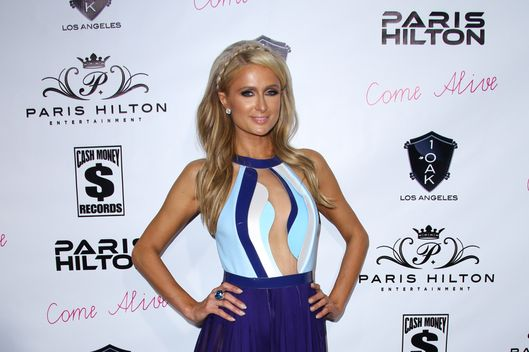 "11 Jul 2014, Los Angeles, California, USA --- Paris Hilton wears extremely revealing dress, almost identical to the sheer dress worn at her last birthday party, this time, at Paris Hilton's New Single ""Come Alive"" Release Party Jul 10 2014 - 1OAK - West Hollywood, California United States. (ALSO INCLUDED ARE FOUR STOCK PHOTOS FROM THE DRESS PARIS WORE (PINK) AT PARIS' BIRTHDAY PARTY on 12/15/13 for comparison). Pictured: Paris Hilton --- Image by ? @Parisa/Splash News/Corbis"