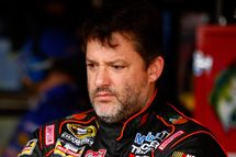RICHMOND, VA - SEPTEMBER 05:  Tony Stewart, driver of the #14 Bass Pro Shops/Mobil 1 Chevrolet, looks on in the garage area during practice for the NASCAR Sprint Cup Series Federated Auto Parts 400 at Richmond International Raceway on September 5, 2014 in Richmond, Virginia.  (Photo by Jared Wickerham/Getty Images)