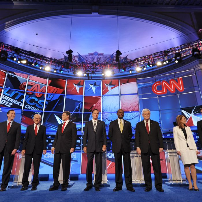 Republican presidential candidates arrive on stage prior to the start of the Republican presidential debate on national security November 22, 2011 at the Daughters of the American Revolution (DAR) Constitution Hall in Washington, DC. The debate is hosted by CNN in partnership with the Heritage Foundation and the American Enterprise Institute. From left are: Former Pennsylvania senator Rick Santorum; Texas Rep. Ron Paul; Texas Gov. Rick Perry; former Massachusetts governor Mitt Romney; businessman Herman Cain; for House speaker Newt Gingrich; Minnesota Rep. Michele Bachmann; and former Utah governor Jon Huntsman. AFP PHOTO / Mandel NGAN (Photo credit should read MANDEL NGAN/AFP/Getty Images)